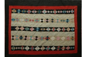 Antique Amish Bars. black and red outside border. Blocks with Soft mustard background 62x79